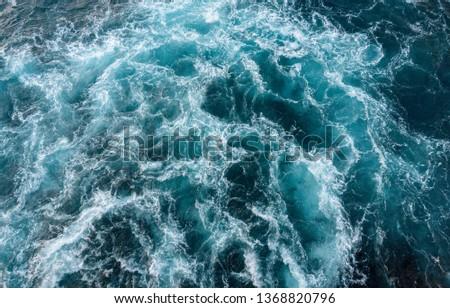 Blue turbid wavy sea water #1368820796