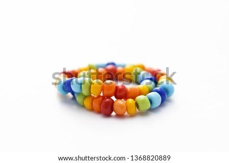 Glass Beads Bracelet Rainbow on White Background, Isolated Beads on White Background, Glass Beads Bracelet, Jewelry making, Jewellery Design, Handmade Jewelry, Handmade Beads Bracelet #1368820889