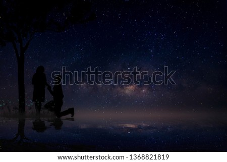 Siluue, a lover, gives love to each other. Under the tree at night #1368821819