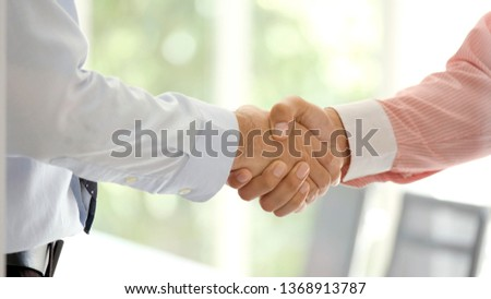 Handshake partnership to corporate work union at business meeting, Close up of business people hand shake team to introduce collaboration company, success in co-working business concept #1368913787
