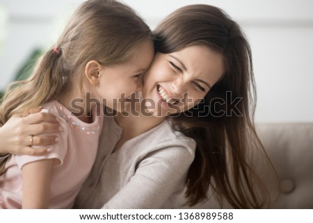 Laughing mother or older sister play with little child, family relatives girls hugging having fun together feels overjoyed. Leisure activity at home with kid, funny weekend, positive emotions concept #1368989588