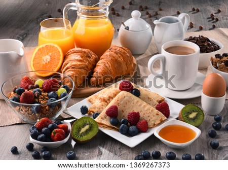 Breakfast served with coffee, orange juice, croissants, cereals and fruits. Balanced diet. #1369267373