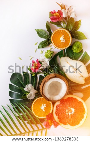 Summer tropical theme background or template with a space for a text, various fruits, green leaves and flowers. Bright summer background #1369278503