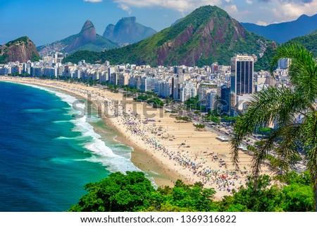 Copacabana beach in Rio de Janeiro, Brazil. Copacabana beach is the most famous beach of Rio de Janeiro, Brazil. Skyline of Rio de Janeiro. #1369316822