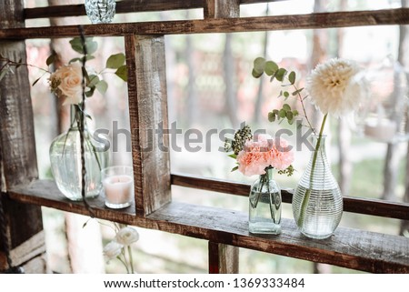 Elements of decor. Flowers, crystal vases, and greens on the holiday