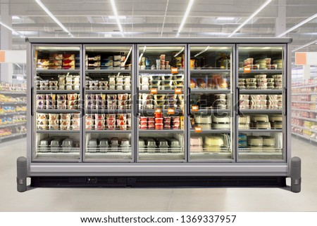 Ice cream and birthday cakes in a glass door freezer at supermarket. Suitable for presenting new packaging among many others. Front view. #1369337957