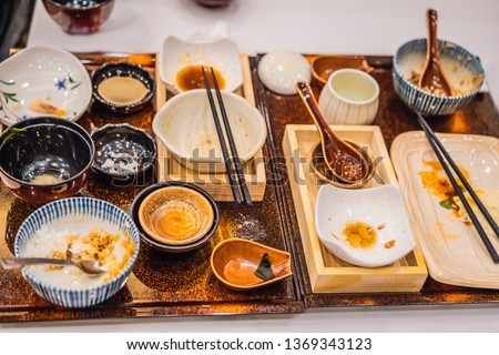 Messy table after meal in Japanese restaurant. Dirty, finish meal, leftovers concepts #1369343123