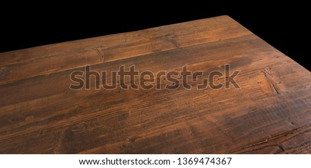 Perspective view of wood or wooden table corner on black background including clipping path Royalty-Free Stock Photo #1369474367