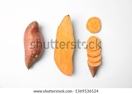 Composition with sweet potatoes on white background, top view Royalty-Free Stock Photo #1369536524