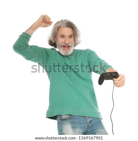 Emotional mature man playing video games with controller isolated on white #1369567901