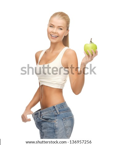 picture of sporty woman showing big pants and apple