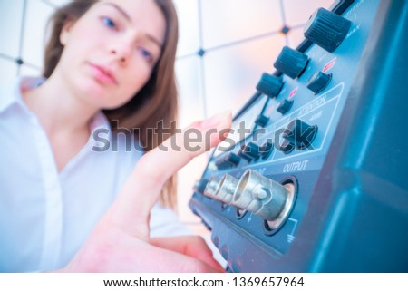 Young woman engineer work with measuring devices in the electronics  laboratory #1369657964