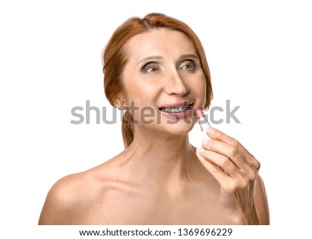 Mature woman with lipstick on white background #1369696229