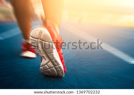Cropped image of handsome man running, back view/close up shoe run for running,Close-up view while running, rear view / short running shoes for running, exercise, jogging  #1369702232