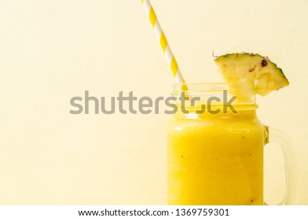 fresh pineapple smoothie glass on wood table - Healthy Drink #1369759301