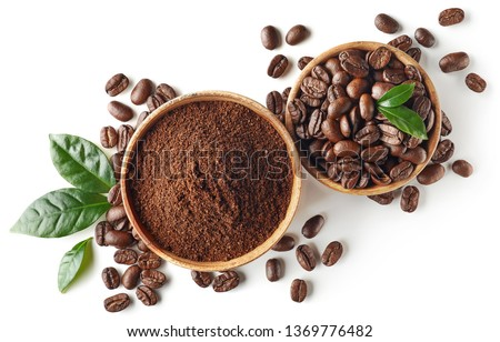 Bowl of ground coffee and beans isolated on white background, top view #1369776482