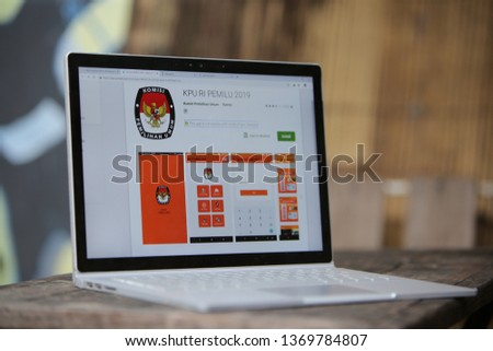 Bojonegoro/Indonesia - April 15 2019. All around the 2019 presidential election. the application of the 2019 presidential election from KPU on the google play store in a photo from the laptop screen. #1369784807