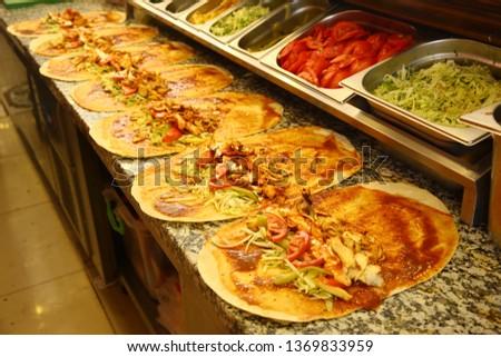 Chicken doner kebab and fresh vegetables in roll of pita bread lavash - Durum Chicken Doner Kebab #1369833959