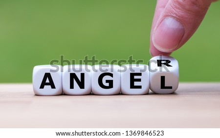 """Having anger or being an angel? Hand turns a dice and changes the word """"anger"""" to """"angel"""". Royalty-Free Stock Photo #1369846523"""