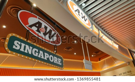 SINGAPORE, 11 Apr, 2019: American fast food giant A&W Restaurants located inside the Jewal Changi Airport in Singapore. A&W returns to Singapore after 16 years #1369855481