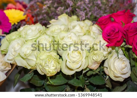 White roses in a flower shop. Flowers in the shop window. #1369948541