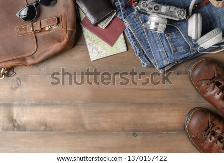 prepare backpack accessories and travel items on wood background with copy space, flat lay, top view background #1370157422
