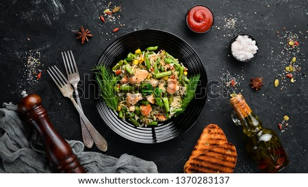 Risotto with chicken fillet and vegetables. Rice. Top view. Free copy space. #1370283137