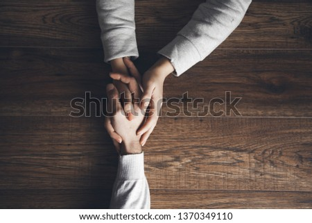 woman and man hand on table #1370349110