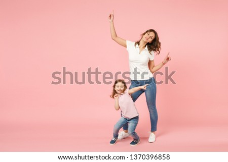 Woman in light clothes have fun with cute child baby girl. Mother, little kid daughter isolated on pastel pink wall background, studio portrait. Mother's Day love family, parenthood childhood concept #1370396858
