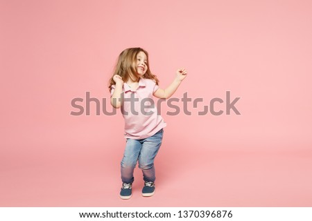 Little cute child kid baby girl 3-4 years old wearing light clothes dancing isolated on pastel pink wall background, children studio portrait. Mother's Day, love family, parenthood childhood concept #1370396876