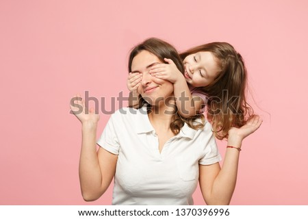 Woman in light clothes have fun with cute child baby girl. Mother, little kid daughter isolated on pastel pink wall background, studio portrait. Mother's Day love family, parenthood childhood concept #1370396996