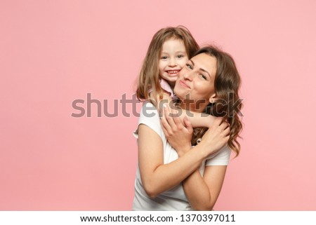 Woman in light clothes have fun with cute child baby girl. Mother, little kid daughter isolated on pastel pink wall background, studio portrait. Mother's Day love family, parenthood childhood concept #1370397011