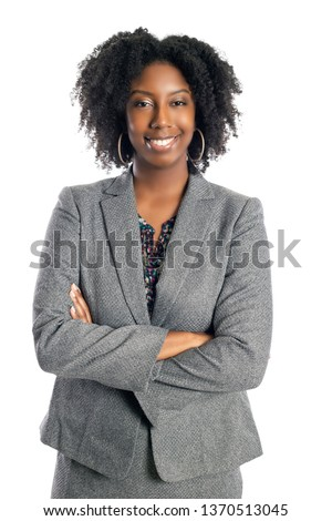 Black African American female businesswoman isolated on a white background looking confident and successful #1370513045