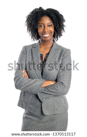 Black African American female businesswoman isolated on a white background looking confident and successful #1370513117