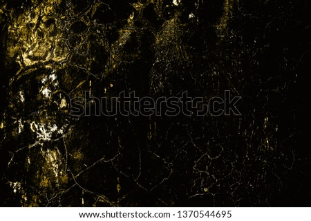 Dark grunge background of golden texture #1370544695