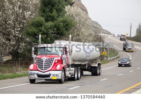 Pittsburgh, PA / USA - March 30 2019: Big rigs in the highway  #1370584460