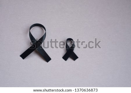 Black  ribbon, symbol of neuroendocrinecancer. Cancer awareness month. Concept of health.  #1370636873