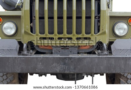 Front detail of military vehicle on white background #1370661086