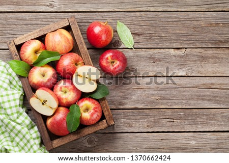 Ripe red apples on wooden table. Top view with space for your text #1370662424