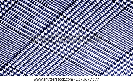 Background texture, pattern. The fabric is thick, warm with a checkered pattern, blue. Stop. You made the right choice by purchasing this photo, your design will be great with this image. #1370677397