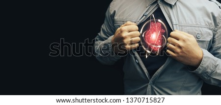 Business man in shirt with a picture neon red heart and atom. Innovative technologies.