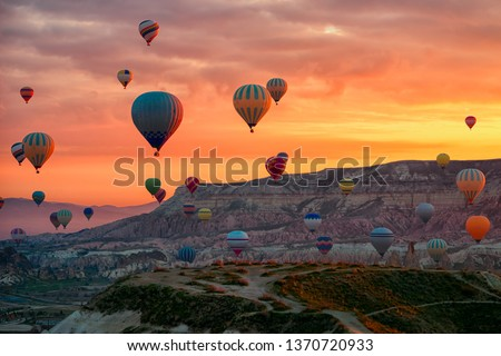 Hot Air balloons flying tour over Mountains landscape spring sunrice Cappadocia, Goreme National Park, Turkey nature background.  #1370720933