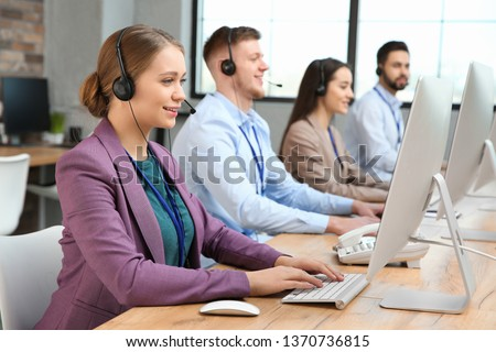 Technical support operators working in modern office #1370736815