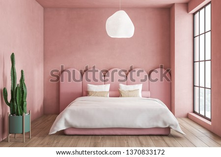 Interior of minimalistic bedroom with pink walls, wooden floor, master bed with original headboard and large window. 3d rendering #1370833172
