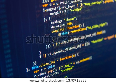 Developing HTML and technology. Programmer inspecting his code on computer screen Programming Javascript on laptop computer screen Programming code abstract company office.