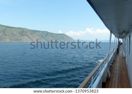 View from the deck of the boat on the coastal mountains of Lake Baikal. #1370953823