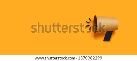 Refer a Friend. Business concept image with paper cup on orange background with copy space. Minimal flat lay #1370982299