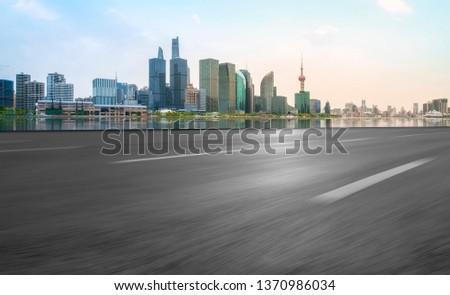 Empty Asphalt Road Through Modern City of Shanghai, China #1370986034
