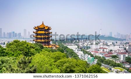 Scenic view of the Yellow crane tower and Yangtze Great bridge the emblematic landmark of Wuhan Hubei China Royalty-Free Stock Photo #1371062156