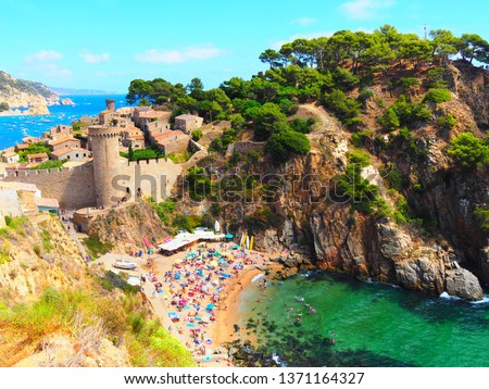 TOSSA DE MAR, SPAIN - AUGUST 22: View of the Old Town in Tossa de Mar, Spain on August 22, 2017. Tossa de Mar is one of the most visited towns in Costa Brava, Girona during the summer holidays. #1371164327